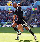 Nicholas Anelka of Chelsea uses his head to get away from Gareth Barry during the Barclays Premier League match between Aston Villa and Chelsea at Villa Park on February 21, 2009 in Birmingham, England.