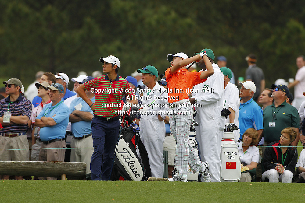 AUGUSTA, April 13, 2013  China's Guan Tianlang (Front, R) competes during the second round of the 2013 Masters golf tournament at the Augusta National Golf Club in Augusta, Georgia, the United States, April 12, 2013. Guan shot a three-over par 75 Friday and stood at four-over 148 after 36 holes.