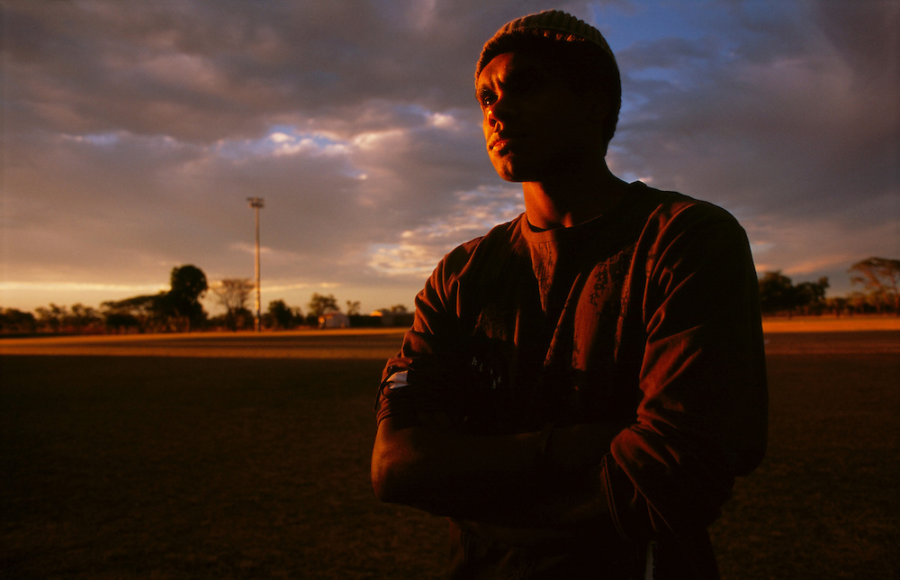 Shane Pickett, 19, a rover with the Halls Creek Hawks, Thursday night training, Halls Creek, The Kimberley, Western Australia. 29 June 2006
