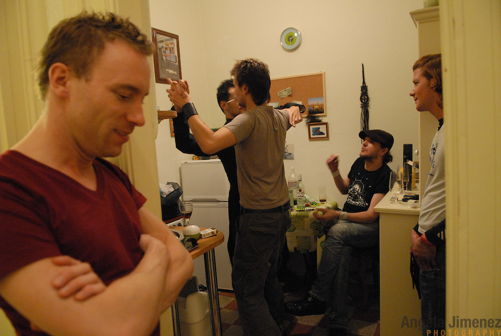"World Champion same-sex ballroom dancers Robert Tristan Szelei, center left, and Gergely Darabos, center right, dance in the kitchen of Darabos' apartment in Budapest, Hungary, under the watch of friends, from left, Berry Bleij, a DJ from Holland,  stylist Mark Lakatos and hair stylist Kerekes Gabor on October 19, 2006 while trying on costumes in preparation for the 2nd annual World Championship Same-Sex Ballroom Dancing competition, held in Budapest on October 21, 2006. ..Szelei and Darabos, who are known as the ""Black Swans,"" are the reigning world champions in men?s Latin same-sex ballroom dancing. They have been training and preparing to host the 2nd annual World Championship and the Csardas Cup, the first-ever Eastern European same-sex ballroom competition, both held at the Korcsarnok arena.  This is the pinnacle event of the blossoming same-sex ballroom scene...Szelei and Darabos went on to win the men?s Standard division and finished fourth in the Latin division. ..The event was organized by the US-based World Federation of Same-Sex Dancing, which hosted the first World Championship Same-Sex championships in 2005 in Sacramento, California. The Black Swans did a large amount of the coordination and planning in Budapest, a city that had never seen an event of this kind. When government funding fell through, they secured funding from patron Desire (accent on the ?e?) Dubounet, owner of the local Club Bohemian Alibi drag club. ..The World Championship events are newly recognized, but same-sex dancers have been competing on a national and international circuit for a number of years, especially in Europe, including at the Eurogames, the Gay Games, the London Pink Jukebox Trophy and the Berlin Open, among others. Countries including the United States, the Netherlands, Germany and, now, Hungary, hold their own national same-sex championships. Hungary held its first national championships in April 2006...Szelei and Darabos spent three months at the Sacramento Dancespo"