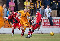 Annan Athletic's James Creaney and Livingston Craig Sibbald. Livingston 1 v 0 Annan Athletic, Scottish League Cup Group F, played 21/7/2018 at Prestonfield, Linlithgow.