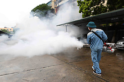 Aug. 16, 2017- Hanoi, Vietnam - A worker sprays insecticides in residential areas in Hanoi, capital of Vietnam. Vietnam has so far this year detected more than 80,500 dengue fever patients, including 24 fatalities, much higher than the numbers in the same period last year, the country's Preventive Medicine Department said. (Credit Image: © Vna/Xinhua via ZUMA Wire)