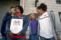 SAN FRANCISCO - SEPTEMBER 8: 11 year old Haily Sharp-Bishop and her sister 8 year old Tyla Sharp-Bishop joins their moms Corey and Angela Sharp-Sabatino as they join a group of supporters for the Same Sex Marriage Bill gather in front of California Supreme Court building on September 8, 2005 in San Francisco, California. With the same sex bill passing in the State Legislature the fate of many California same sex couples is now up to California Governor Arnold Schwarzenegger who is expected to veto the bill. (Photo by David Paul Morris)