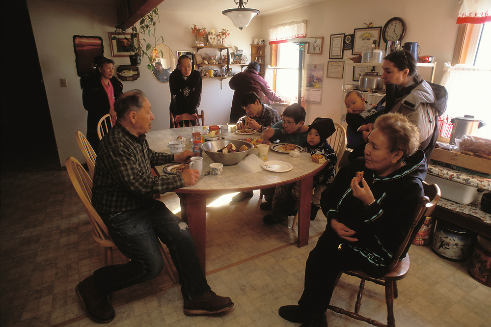 Barrow, Alaska, Dining room of a Barrow household in which four generations of the same family are gathered.