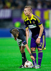 Referee Clément Turpin (FRA) with foam for Dare Vrsic of Maribor during football match between NK Maribor and Sporting Lisbon (POR) in Group G of Group Stage of UEFA Champions League 2014/15, on September 17, 2014 in Stadium Ljudski vrt, Maribor, Slovenia. Photo by Vid Ponikvar  / Sportida.com