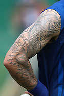 Mitchell Johnson of Mumbai Indians tattoo during the Mumbai Indians training session ahead of their Karbonn Smart CLT20 2013 match against Highveld Lions held at the Sawai Mansingh Stadium in Jaipur on the 26th September 2013<br /> <br /> Photo by Shaun Roy-CLT20-SPORTZPICS <br /> <br /> Use of this image is subject to the terms and conditions as outlined by the BCCI. These terms can be found by following this link:<br /> <br /> http://www.sportzpics.co.za/image/I0000SoRagM2cIEc