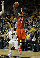 November 29, 2011: Clemson Tigers guard T.J. Sapp (1) puts up a shot as Iowa Hawkeyes guard Matt Gatens (5) looks on during the second half of the NCAA basketball game between the Clemson Tigers and the Iowa Hawkeyes at Carver-Hawkeye Arena in Iowa City, Iowa on Tuesday, November 29, 2011. Clemson defeated Iowa 71-55 in the Big Ten-ACC Challenge game.