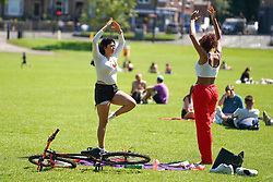 © Licensed to London News Pictures. 23/06/2020. Sheffield , UK. Members of the public exercising at Endcliffe Park, Sheffield . The Met Office has issued warnings as the UK is set to bask in temperatures reaching a sweltering 33 degrees celsius  across the UK.Photo credit: Ioannis Alexopoulos/LNP