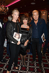 Left to right, TAMARA BECKWITH, JOAN COLLINS and MARIO TESTINO at a party to celebrate the publication of 'Passion for Life' by Joan Collins held at No41 The Westbury Hotel, Mayfair, London on21st October 2013.