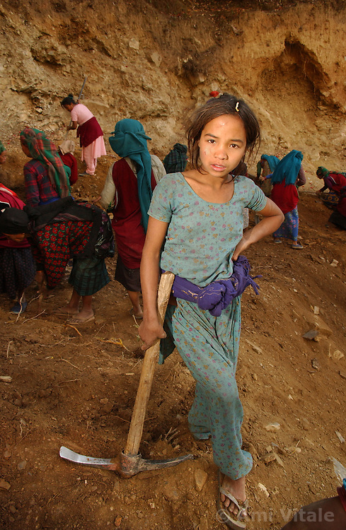 A child works on the road from Rolpa to Thabang in western Nepal, Nepal March 14, 2005. Nearly every citizen living in the Maoist controlled area must work for 15 days straight, manually digging through the mountaineous region to construct the road.(Ami Vitale)