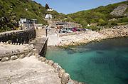 Warm summer sunshine calm water, Lamorna Cove, Cornwall, England, UK