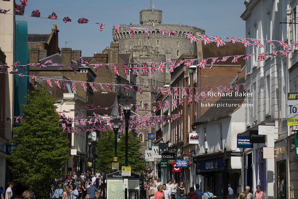 Union jack bunting hangs between shops as the royal town of Windsor gets ready for the royal wedding between Prince Harry and his American fiance Meghan Markle, on 14th May 2018, in London, England.