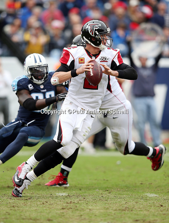 Atlanta Falcons quarterback Matt Ryan (2) is chased out of the pocket on a second quarter pass play by Tennessee Titans linebacker Brian Orakpo (98) during the 2015 week 7 regular season NFL football game against the Tennessee Titans on Sunday, Oct. 25, 2015 in Nashville, Tenn. The Falcons won the game 10-7. (©Paul Anthony Spinelli)