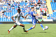 Joe Ralls of Cardiff City and Hadi Sacko of Leeds United during the EFL Sky Bet Championship match between Cardiff City and Leeds United at the Cardiff City Stadium, Cardiff, Wales on 17 September 2016. Photo by Andrew Lewis.