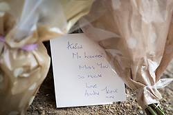 © Licensed to London News Pictures. 21/04/2018. London, UK. A card is left with flowers near the spot opposite Morden Underground, south London near where a man died following an assault. Police were called by the London Ambulance Service at 22:17hrs on Thursday, 19 April, after ambulance staff suspected that a man collapsed on London Road in Morden had been assaulted. The 32-year-old man was taken to a south London hospital in a critical condition. He died at 23:45hrs on Friday, 20 April. His next of kin have been informed. Photo credit: Peter Macdiarmid/LNP