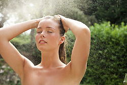 Young Woman Showering Outdoors