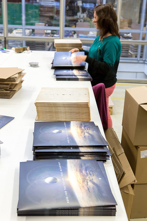 Germany - Deutschland - Optimal Media GmbH - Vinyl Schallplatten Pressung, Fertigung, Produktion; Vinyl Record Pressing - the biggest factory in Germany for record production; HERE:Packaging; new Album from Paul Mc Cartney - Hope for the Future;        Roebel, 11.12.14; © Christian Jungeblodt