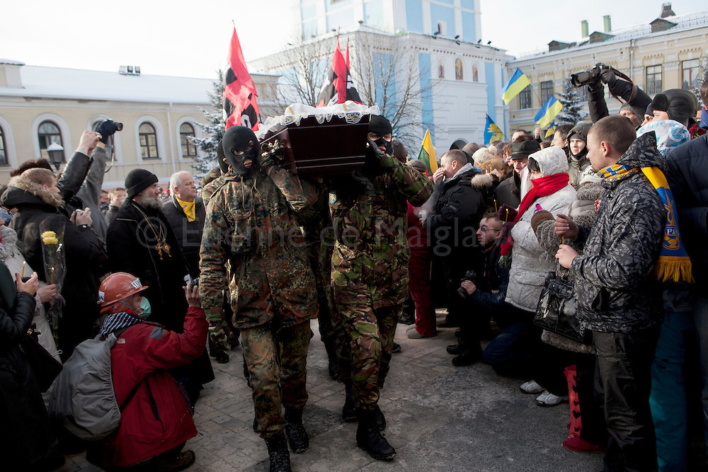 Funeral of Mikhail Zhiznevsky arrives at  Saint Michael Cathedral in Kiev. 26 JAN 2014.