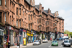 View along High Street with traditional sandstone tenement apartment buildings  in East End of Glasgow, Scotland, United Kingdom