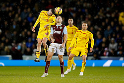 Adam Lallana of Liverpool and Scott Arfield of Burnley compete in the air - Photo mandatory by-line: Rogan Thomson/JMP - 07966 386802 - 26/12/2014 - SPORT - FOOTBALL - Burnley, England - Turf Moor Stadium - Burnley v Liverpool - Boxing Day Christmas Football - Barclays Premier League.