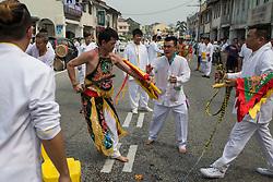 © Licensed to London News Pictures. 18/10/2015 Batu Gajah, Perak, Malaysia. A devotee in trance dances on a street during the Nine Emperor Gods Festival celebration in Batu Gajah, Malaysia,, Sunday, Oct. 18, 2015. Photo credit : Sang Tan/LNP
