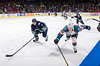KELOWNA, CANADA - JANUARY 5: Conner Bruggen-Cate #20 of the Kelowna Rockets reaches for the puck while checked by Reece Harsch #7 of the Seattle Thunderbirds on January 5, 2017 at Prospera Place in Kelowna, British Columbia, Canada.  (Photo by Marissa Baecker/Shoot the Breeze)  *** Local Caption ***