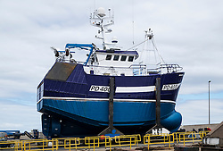 Fishing trawler under repair at shipyard in Macduff in Aberdeenshire Scotland