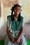 School girl seated on thinnai of a home in Tarangambadi. Tarangambadi (Tranquebar) was a small Danish Colony on the South East Coast of India.