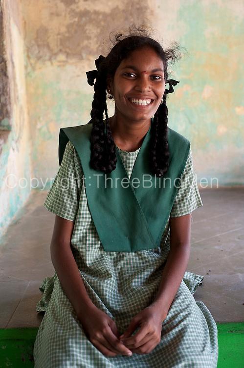 School girl seated on thinnai of a home in Tarangambadi. Tarangambadi (Tranquebar) was a small Danish Colony on the South East Coast of India.