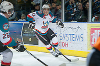 KELOWNA, CANADA - DECEMBER 27:  Carter Rigby #11 of the Kelowna Rockets skates on the ice against the Kamloops Blazers at the Kelowna Rockets on December 27, 2012 at Prospera Place in Kelowna, British Columbia, Canada (Photo by Marissa Baecker/Shoot the Breeze) *** Local Caption ***
