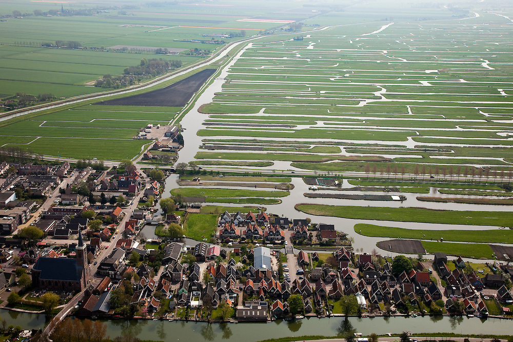 Nederland, Noord-Holland, Gemeente Schermer, 28-04-2010; Schermerhorn met Hervormde kerk, de polder Eilandspolder op het tweede plan.luchtfoto (toeslag), aerial photo (additional fee required).foto/photo Siebe Swart