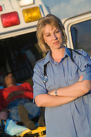 Portrait of paramedic by ambulance