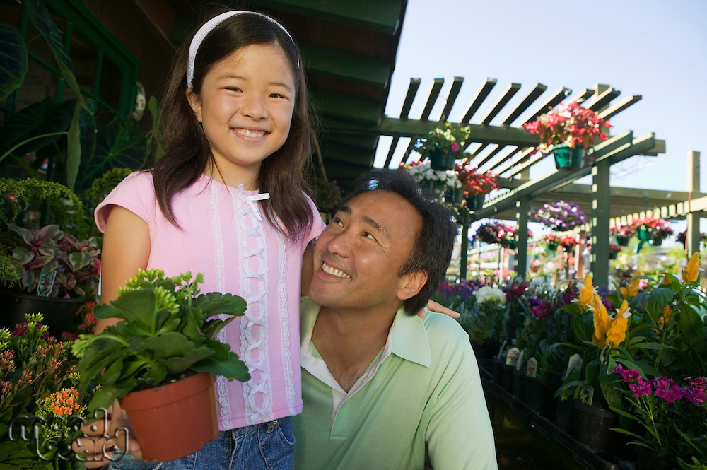 Father and Daughter Shopping for Plants