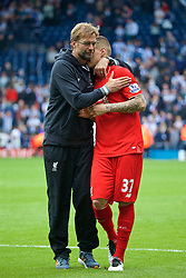 WEST BROMWICH, ENGLAND - Sunday, May 15, 2016: Liverpool's manager Jürgen Klopp embraces Martin Skrtel after the 1-1 draw against West Bromwich Albion during the final Premier League match of the season at the Hawthorns. (Pic by David Rawcliffe/Propaganda)