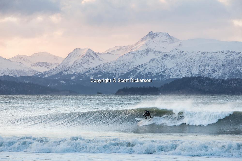 Iceman surfing Alaska in winter.