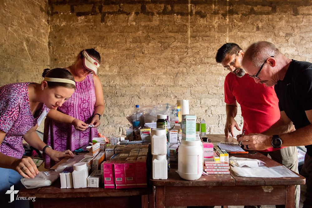 LCMS Missionaries Molly Christensen, Angie Thompson, the Rev. Doug Thompson, and the Rev. Gary Schulte work the pharmacy on the second day of the LCMS Mercy Medical Team on Tuesday, May 8, 2018, in the Yardu village outside Koidu, Sierra Leone, West Africa. LCMS Communications/Erik M. Lunsford