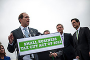 Flanked by Republican House leadership, Rep. DAVE CAMP (R-MI) speaks to the media on Capitol Hill Wednesday about a $46 billion economic stimulus bill  that would cut taxes for small businesses.