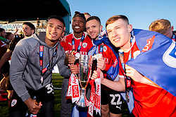Jacob Brown of Barnsley, Victor Adeboyejo of Barnsley, Jordan Williams of Barnsley and Callum Styles celebrate after the final whistle of the match after Barnsley secure automatic promotion to the Sky Bet Championship - Mandatory by-line: Ryan Hiscott/JMP - 04/05/2019 - FOOTBALL - Memorial Stadium - Bristol, England - Bristol Rovers v Barnsley - Sky Bet League One
