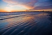 Middletown RI  - The blues and oranges of a winter sunset at Second beach with St. Georges chapel in the distance.