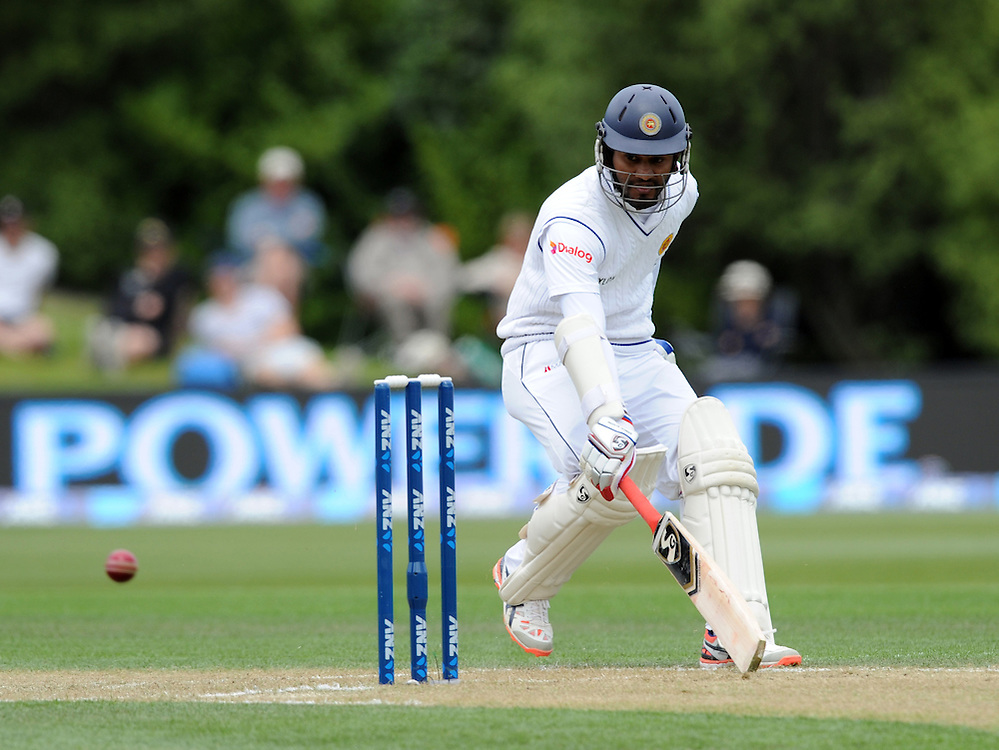 Sri Lanka's Dimuth Karunaratne makes his ground against New Zealand on day two of the first International Cricket Test, University Cricket Oval, Dunedin, New Zealand, Friday, December 11, 2015. Credit:SNPA / Ross Setford