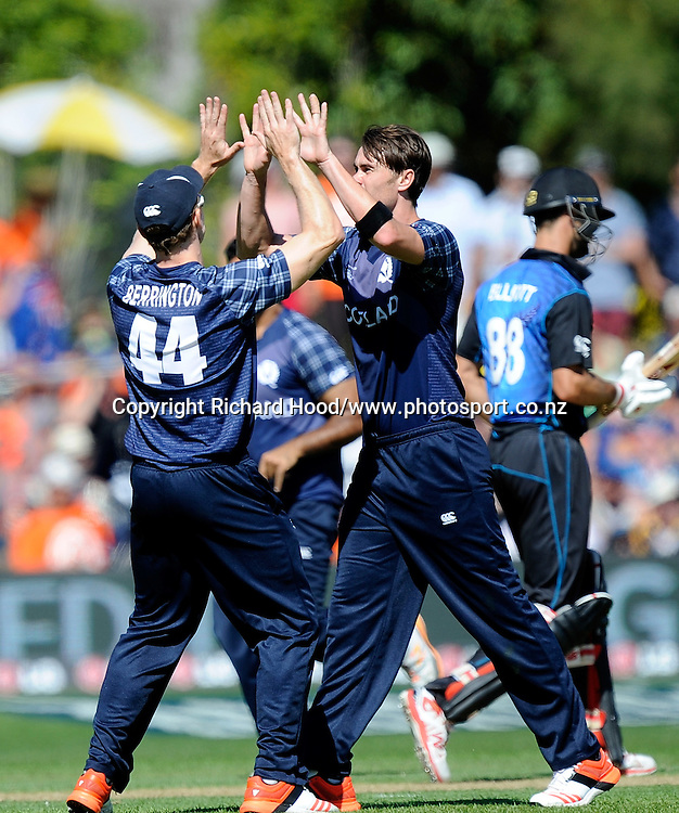 Richie Berrington celebrates with team mate after the wicket of Grant Elliott during the ICC Cricket World Cup match between New Zealand and Scotland at university oval in Dunedin, New Zealand. Photo: Richard Hood/photosport.co.nz
