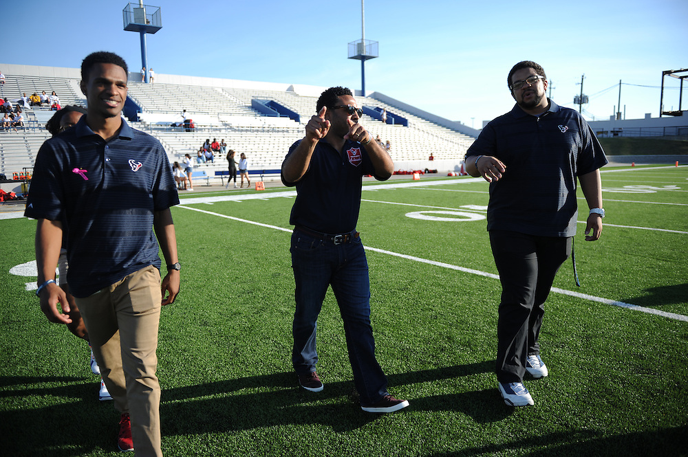 Houston Texans representatives participate in the Bellaire vs Lamar football game at Delmar Stadium, October 10, 2015.