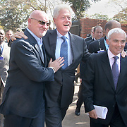 July 14, 2006 - President Clinton, with Sir Tom Hunter (left), a Scottish philanthropist who launched the Clinton Hunter Development Initiative, and philanthropist Frank Guistra, arrive at the presidential palace in Malawi to sign an agreement to launch the Clinton Hunter Development Initiative. Photo by Evelyn Hockstein
