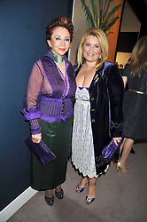 Left to right, CHRISANTHY LEMOS and           at a party to celebrate the publication of Elena Makri Liberis's book 'Every Month, Same day' held at Sotheby's, 34-35 New Bond Street, London on 5th May 2009.
