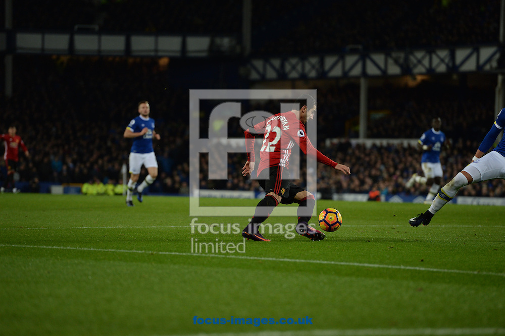 Henrikh Mkhitaryan of Manchester United (left) shoots at goal during the Premier League match at Goodison Park, Liverpool<br /> Picture by Russell Hart/Focus Images Ltd 07791 688 420<br /> 04/12/2016