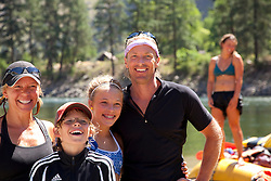 Portrait of healthy family and river guide taken while on a multi-day raft trip along the Main Salmon River in central Idaho.
