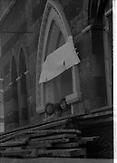 05/04/1978.04/05/1978.5th April 1978.Photograph of students looking out from Molesworth Hall.  They are staging a sit-in to protest its demolition.  Molesworth Hall was built in 1857 and was designed by the architects Deane & Woodward.