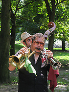 Diuble trumpet player in Central Park