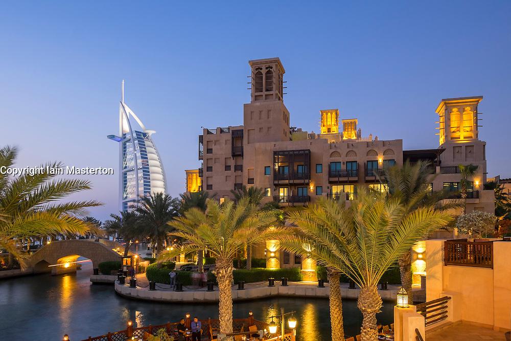 Evening view of Madinat Jumeirah and Burj al Arab Hotel in Dubai United Arab Emirates