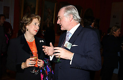 KATE AGIUS and SIR TIMOTHY CLIFFORD at a reception to open an exhibition entitled 'Boucher Seductive Visions' at The Wallace Collection, Manchester Square, London W1 on 29th September 2004.NON EXCLUSIVE - WORLD RIGHTS
